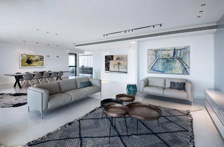This apartment by Michal Han Interior Design faces Tel Aviv's beautiful seafront. The planning process was both unique and challenging as a result of its semi-circular shape #livingroom