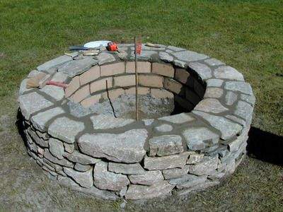 HOW TO BUILD A STONE FIRE PIT... from a guy that doesn't use concrete hollow blocks... trust me... they crumble when exposed to fire...