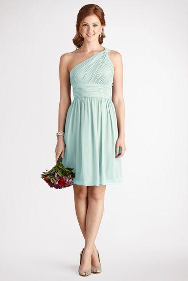 12ec47b7257e Subtle ruching highlights this flowy one shoulder beach glass chiffon dress  with a flattering set in waist.