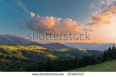 Dramatic vibrant sunset sky over mountains range. Carpathian mountains. Ukraine.