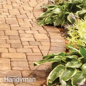 Landscaping: Tips for Your Backyard -  Building brick paths and stone walls creates a magical landscape. It's also hard work. These tips will help you work smarter and faster and they'll help ensure that your paths and walls look as good in 20 years as they do the day you finish.