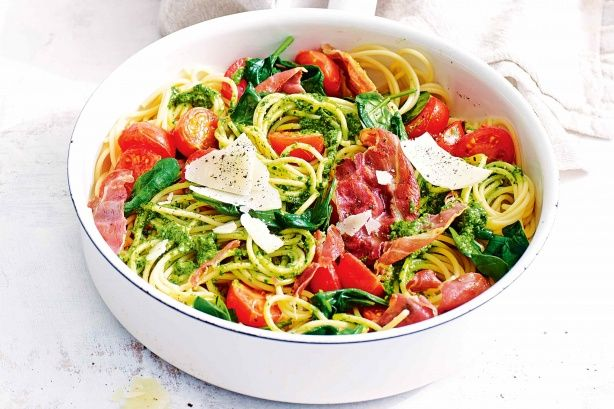 Whip up a fresh Italian pasta dish in under 20 minutes with this quick and easy cherry tomato and pesto spaghetti recipe.