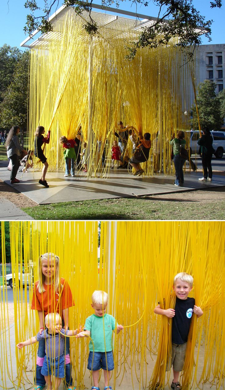 A large outdoor installation of stringy rubber tubes that kids can tie into knots, or grab in bunches to climb or swing, or just run through! Blanton Museum of Art, Houston, Texas.