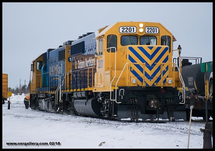 620 Conductor AJ clears switch points while he and Mildred run around their recently arrived tonnage with their power GP40-2 2201 and GP38-2 1801 at Cochrane Feb. 17th.