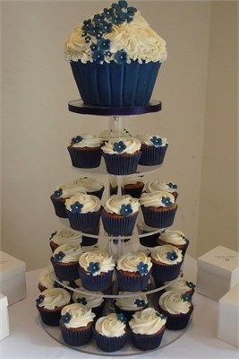 Navy blue cupcakes with matching giant cupcake top tier  #navy & white retro wedding board... Wedding ideas for brides, grooms, parents & planners ... https://itunes.apple.com/us/app/the-gold-wedding-planner/id498112599?ls=1=8 … plus how to organise an entire wedding, without overspending ♥ The Gold Wedding Planner iPhone App ♥