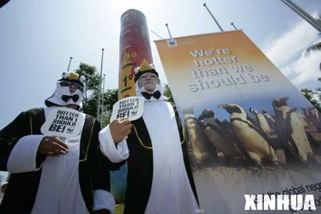 Environmentalists dressed as penguins hold a protest against the global warming threatening the living environment of the penguins in Antarctica, in Bali, Indonesia, Dec. 11, 2007. A new report of the World Wild Foundation tells that the four species of penguins that breed on the Antarctic continent are under escalating pressures. For some, global warming is destroying the ground on which penguin raise their young.