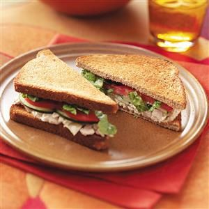 "Tuna Caesar Sandwiches Recipe -""I've always loved tuna sandwiches because they're such a cinch to make. Plus, they're versatile; you can add so many different ingredients to tuna."" —Gloria Bradley, Naperville, Illinois"