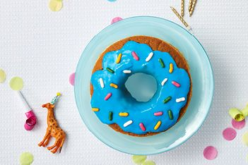 A cake pretending to be a donut? That's two desserts in one! Here's how to make a donut-shaped cake.