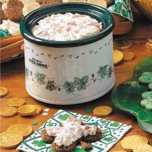 Crock pot reuben dip  8 oz chopped deli corned beef  8 oz cubed cream cheese  8 oz saurkraut, rinsed and drained  8 oz sour cream  4 oz (1 c.) shredded swiss cheese  2 hours on low  serve with rye