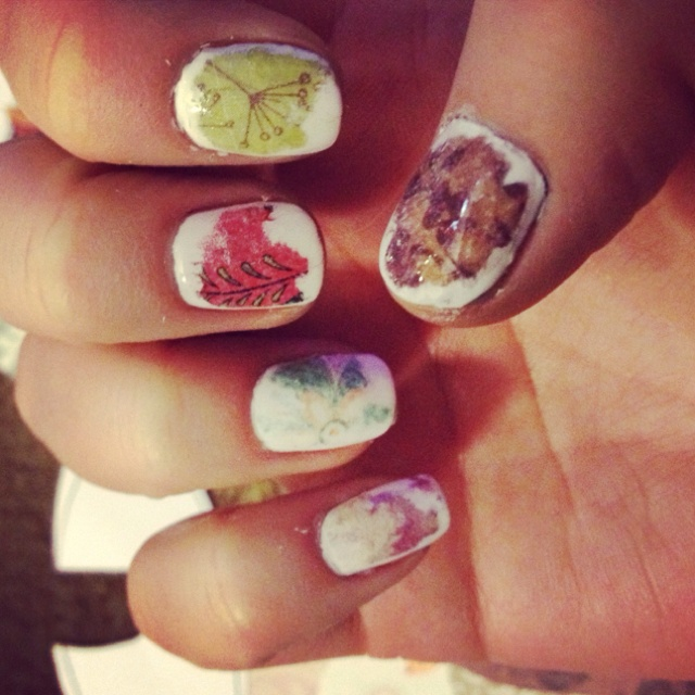 Scrapbook paper nails. Paint nails, soak nail in rubbing alcohol, place scrapbook paper on nail. Then dip finger into rubbing alcohol with paper and press hard. Peel off paper, rub excess paper then paint with clear coat