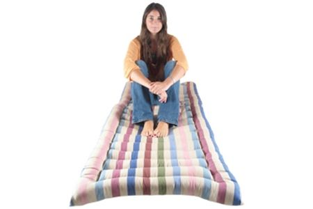 This hand-made roll up bed is not only great looking with it's lovely mute colours it is a revolution in terms of versatility and what it can be used for. Made from heavy cotton and fairly light weight, it can be used for many things and is ideal for having people stay over when you are short of room and indeed beds.