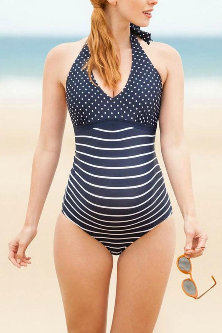 One of our most popular swimwear styles the Navy & White Stripe Halterneck Maternity Bathing Suit is guaranteed to make a splash. Super chic nautical inspired styling looks fantastic on every figure with the halterneck offering extra support and lift to your bust.  Fit and features      Designed to fit throughout pregnancy     One-piece     Ideal for pool or beach     Halterneck     Internal shelf bra     82% Nylon 18% Spandex     Machine washable     To prolong the life of your maternity…
