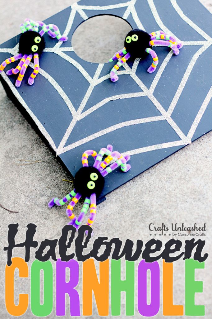 DIY Cornhole Halloween Game For Kids. You throw the spiders! SO stinkin' cute.