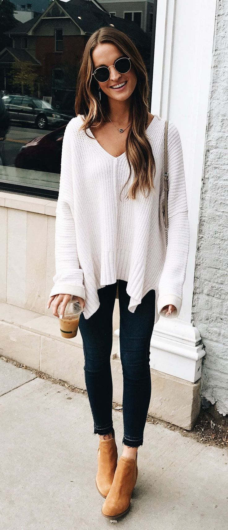 #fall #outfits white sweater, black leggings, and pair of brown boots