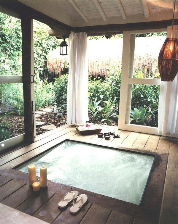 dreaming of a setup like this. hot tub on the backporch, with a garden or forest right outside the window. picturing worn persian rugs and crocheted hammock chairs or a round hammock bed.