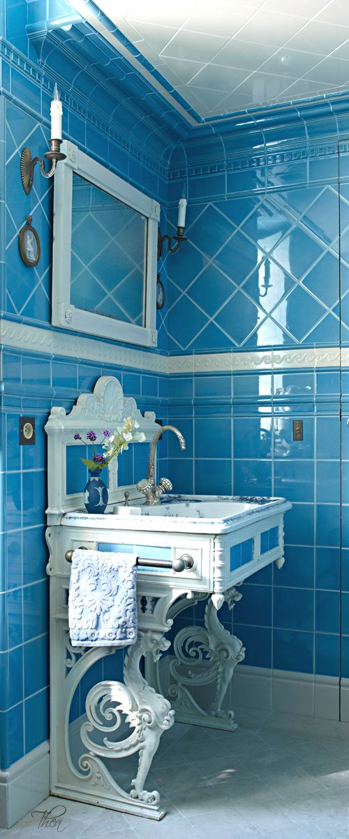 French Flair ● Bathroom. Blue tile walls and white wrought iron vanity. This is so pretty. I love it.