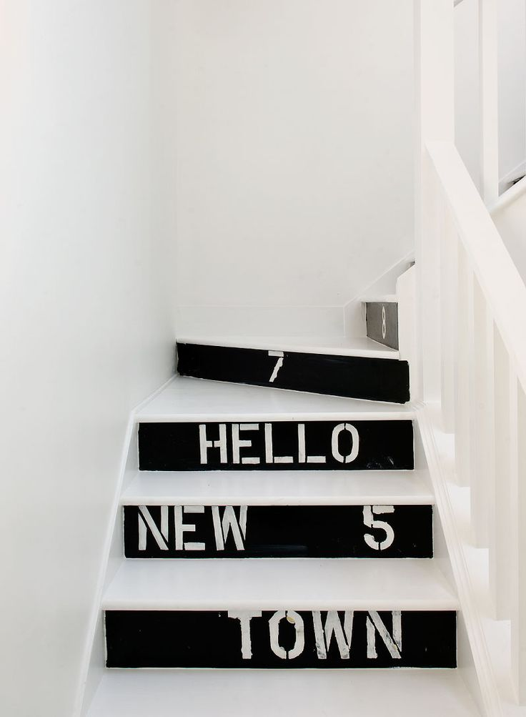 A whimsical hand stenciled touch by the Novogratzes on the stairs of a Hampton's Home.