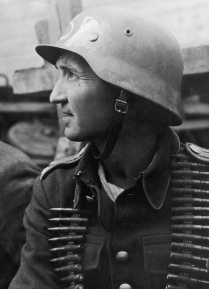 A partisan from a village in Czech Sudetenland takes part in the liberation of Prague from Nazi rule at the end of World War II, May 1945. He is wearing a captured German helmet with the insignia erased. (Photo by FPG/Hulton Archive/Getty Images)