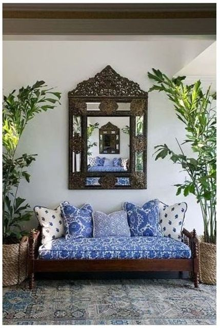 blue and white daybed decor with dark wood ornate furniture