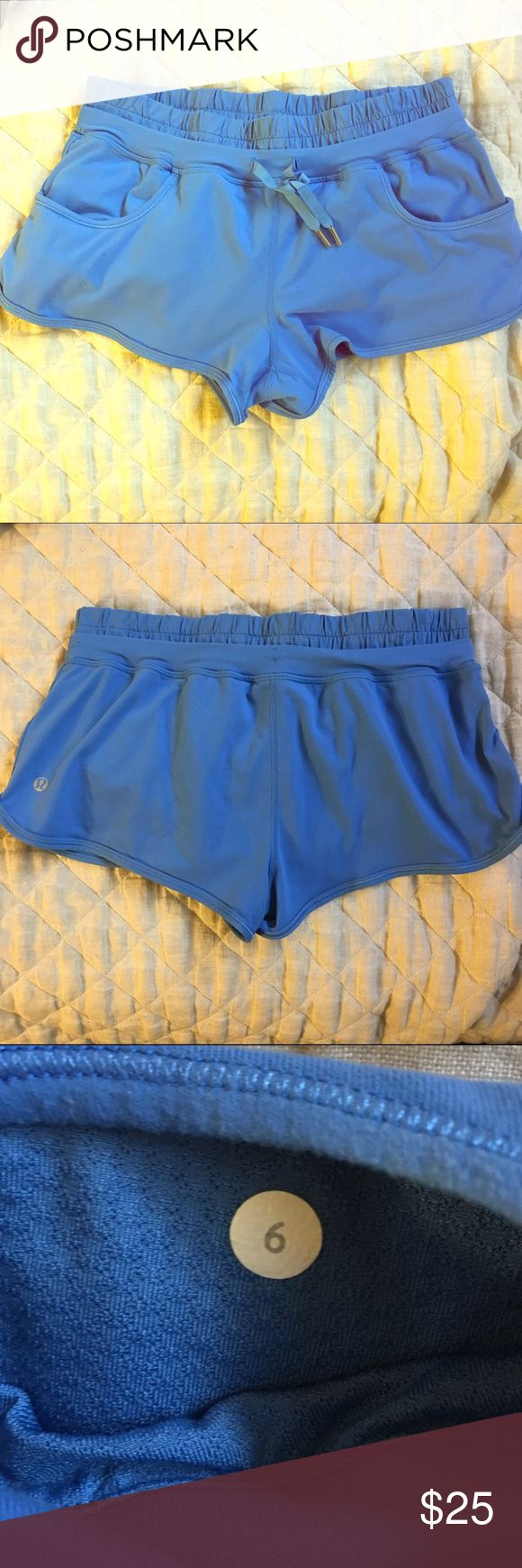 Lululemon Run Shorts 6 Good clean condition. MILD pilling in one tiny spot, otherwise good. Nice royal blue color. Size 6. Interior underwear. lululemon athletica Shorts