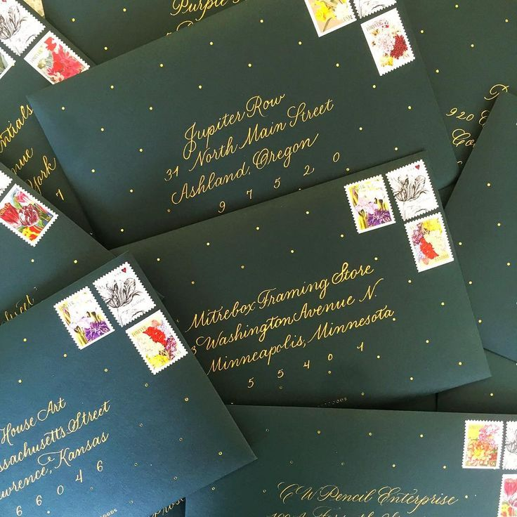 gold calligraphy on hunter green envelopes