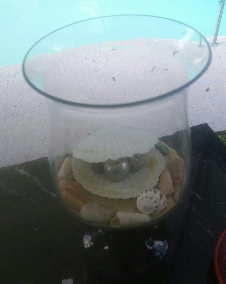 Decoración hecha con caracoles