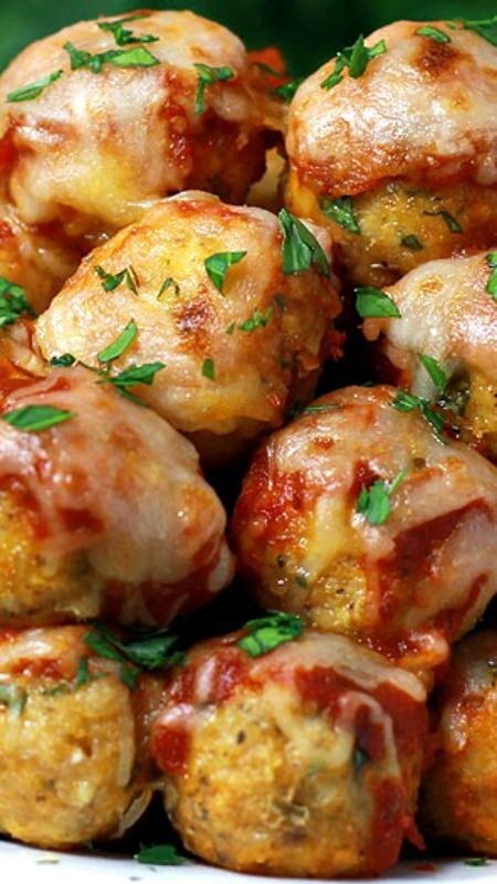 Chicken Parmesan Meatballs ~ Your favorite chicken Parmesan transformed into these popable chicken Parmesan meatballs.  This recipes is ready in just 30 minutes.