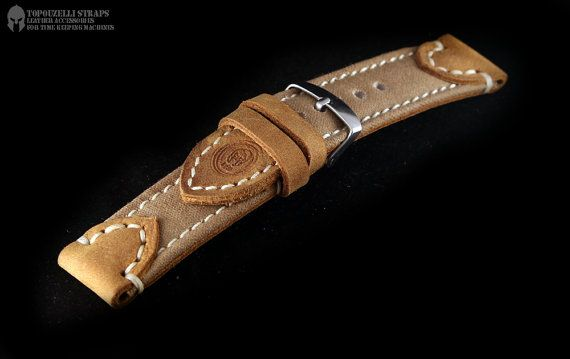 Handmade watch strap. E26. Veg tan leather and bbc canvas. 24-24 mm 125/75 mm 4 mm thick Steel buckle. Unique work Please feel free to ask for more detailed pics.