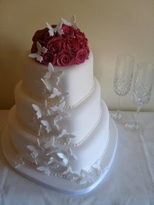 3 tier heart shaped cake with sugar roses and butterflies by the lovely Shelly at Cakes by Shelly