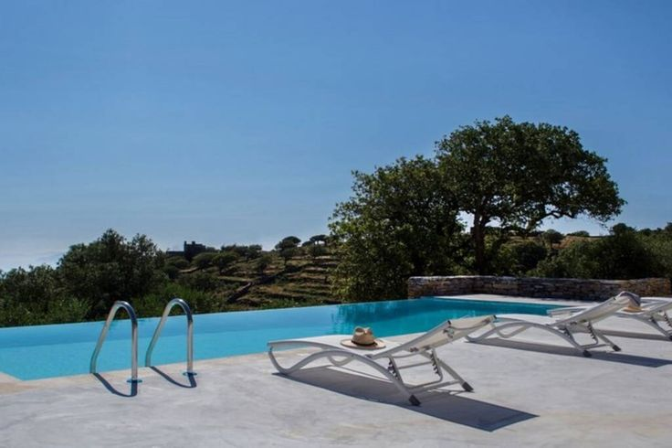 """House in Kéa, Greece. Villa Oliva is a luxurious serene architect estate with sea view and an infinity pool, situated in a beautiful property of 2500m2, full of olive and oak trees. It is located in the area of """"Pera Meria"""", the greenest region of Kea (Tzia). Ideal for..."""