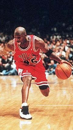 Michael Jordan's first retirement didn't quite last two seasons, as he returned to the Bulls and donned No. 45, since his original No. 23 was hanging from the rafters. Here he drives past New York Knicks guard John Starks at Madison Square Garden on a night in which he scored 55 points.