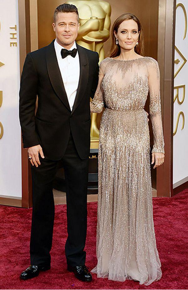 Angelina Jolie and Brad Pitt at 2014 Oscars www.finditforweddings.com #Celebrity fashion