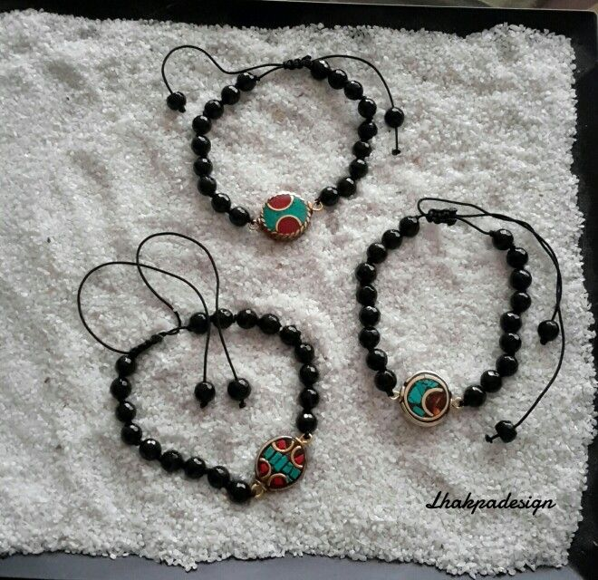 Adjustable Bracelets / Onyx bead with Tibetian Mosaic Charm .