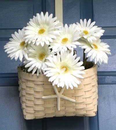 Cute front door decoration for summer.  I'd pick some much brighter flowers, but I like the basket idea a lot.