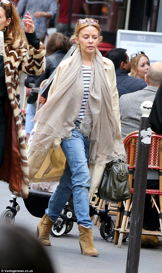 Stylish in stripes: Kylie Minogue looked sophisticated as ever in her off-duty look as she...