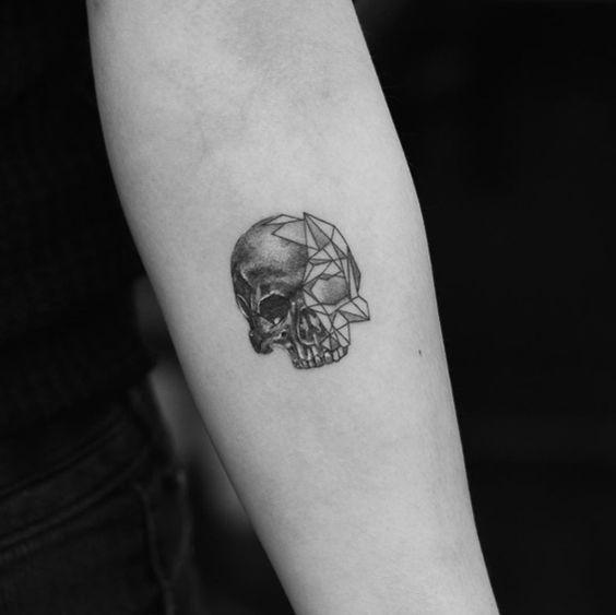 Small geometric skull tattoo by Evan Tattoo