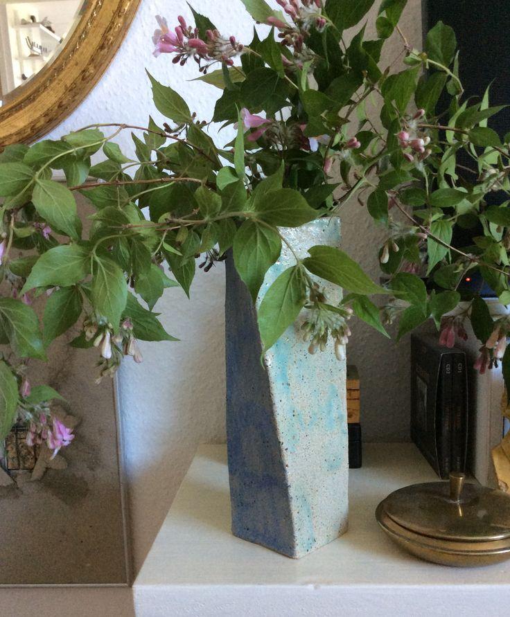 Unique stoneware vase with queen bush branches