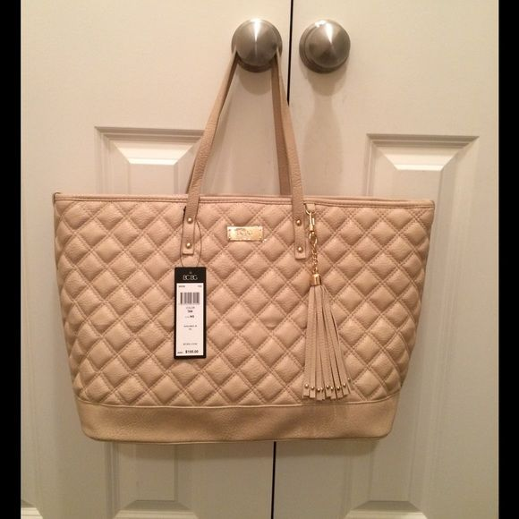New with tags BCBG tote purse SALE New with tags BCBG tan padded tote retail $195+ tax removable Tassel. Accepting reasonable offers BCBG Bags Totes