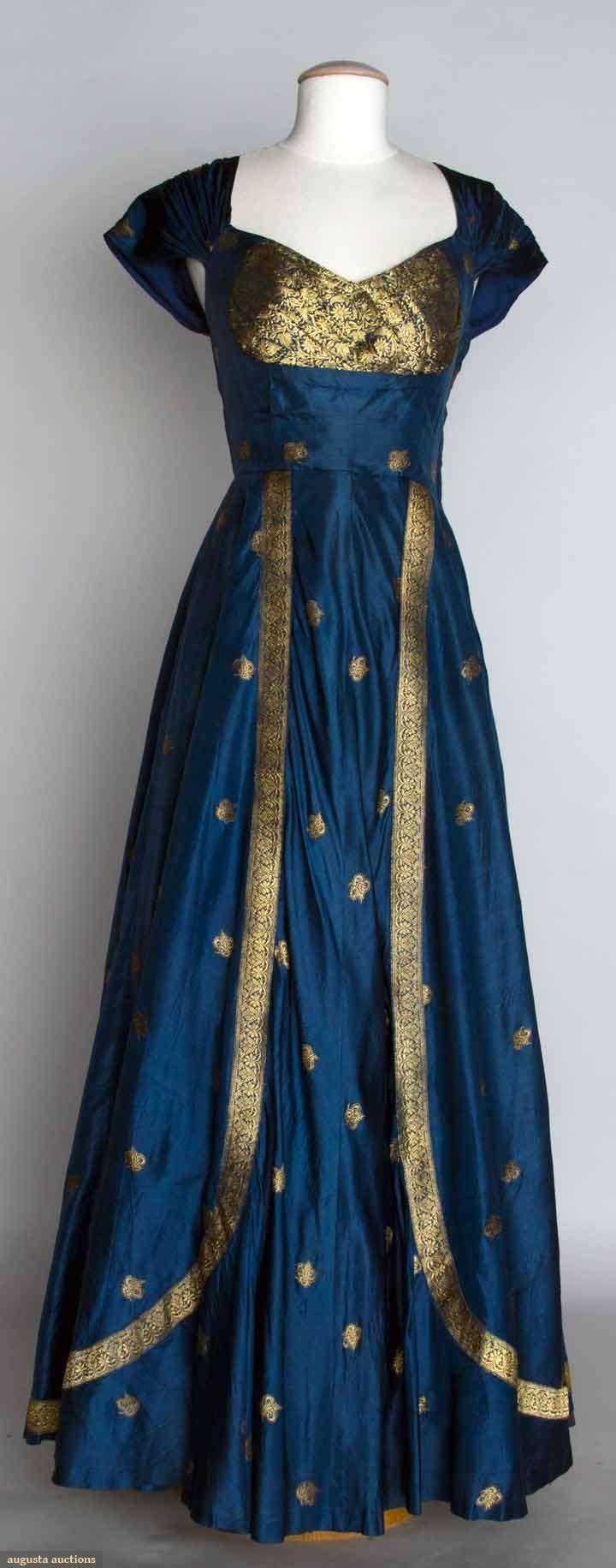 "BLUE & GOLD EVENING DRESS, 1950 Blue silk taffeta w/ metallic gold brocade, fashioned from Indian sari, B 33"", W 27.5"", L 60"", excellent."