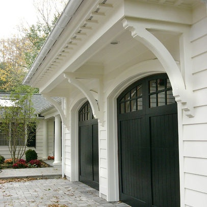 White brick with black garage doors