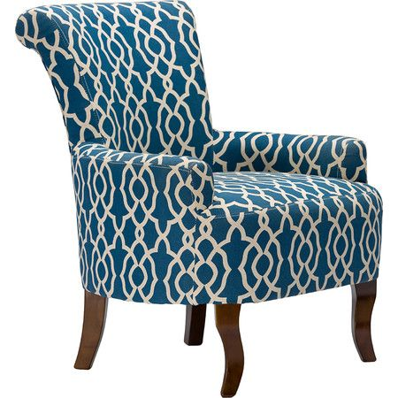 This armchair takes its inspiration from the classic lines of mid-century design, finished in a sophisticated, modern navy blue patterned fabric. The scro...