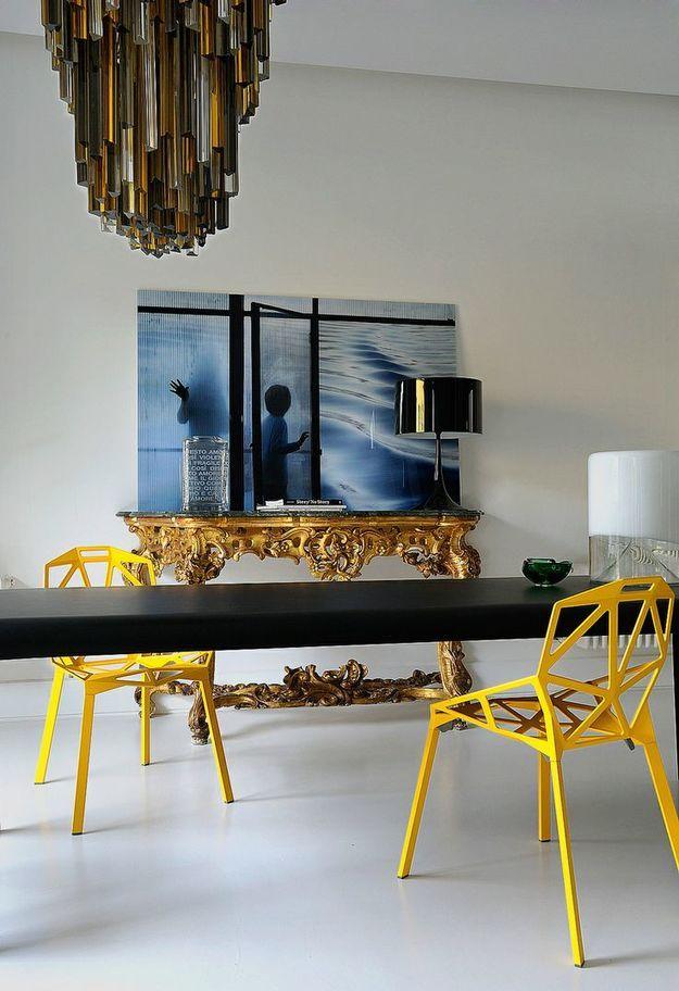 An elaborate gilt console table adds a