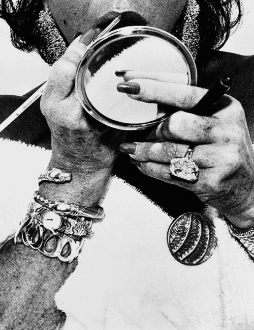 Elizabeth Taylor photographed by Herb Ritts. Since it's the year of the snake I gotta give props to Liz's snake bracelet.