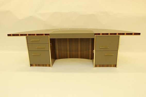 This is the Keynote desk as designed and manufactured by R J Hoppe Inc. It's a museum quality piece of high end executive furniture. An executive desk. It's style might be mid century modern meets 2013. These pictures tell part of the story of it's construction. For the full story please follow this link to a 5 minute YouTube video of the project. http://www.youtube.com/watch?v=cRhNE9MT6Og