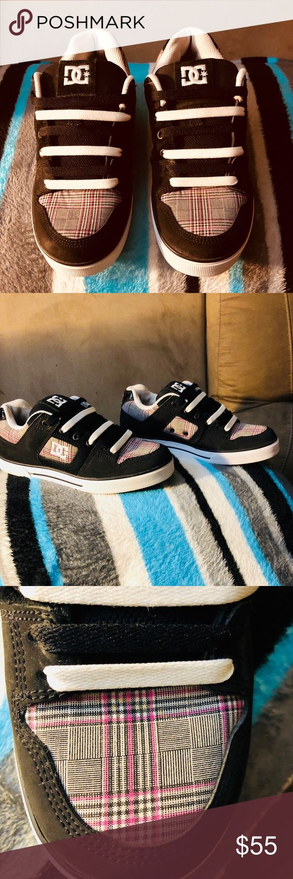 Women's DC sneakers Women's size 7.5 skateboard style sneakers by DC. Leather shoe with rubber soles, black and white sneaker with pink, black and white plaid print throughout. Worn just once. PERFECT CONDITION!! DC Shoes Athletic Shoes