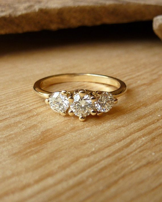 I have one just like this! :) Three Stone Prong Set Diamond Ring by kateszabone on Etsy, $2795.00