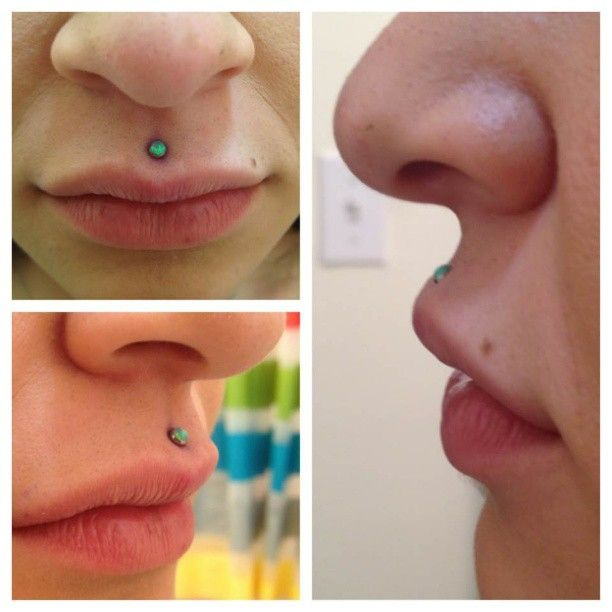 A philtrum piercing with a green opal by #neometal