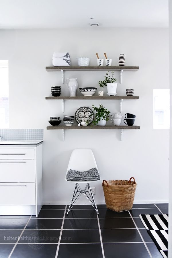 I like the objects on the shelves, a nice eclectic touch to super modern look