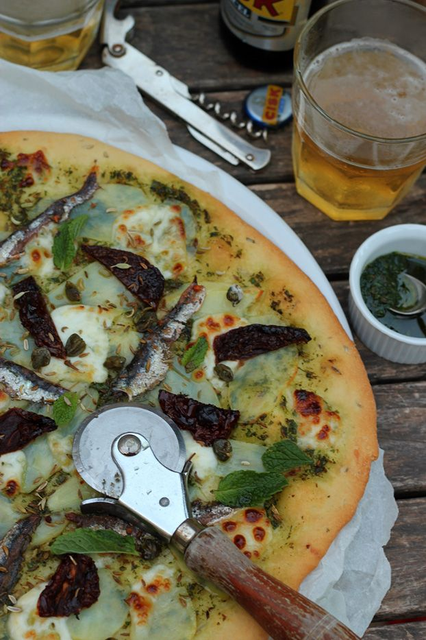 'Gozitan' pizza from the Maltese Islands: goats' cheese, anchovy & potato. With local Cisk beer - perfect Saturday night!