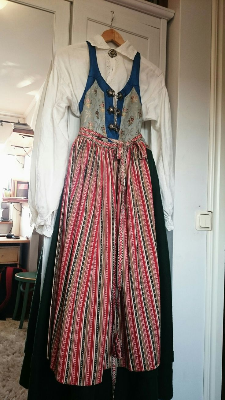 "Swedish folklore, Oxie härad, Skåne (Scania). A dress like this, where the bodice and skirt is sewn together as one, is called ""livkjol"". The dress from Scania is strongly influed by the renaissance era. The bodice is made of brocaded silk and the skirt is made by green wool."
